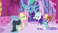 Rarity levitates masquerade dress in front of Fluttershy S5E21