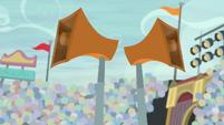 Stadium speakers blaring with sound S9E6