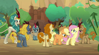 AJ and Fluttershy walk away from Kirin S8E23