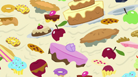 Cakes and snacks clutter the screen S8E24