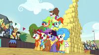 Rodeo clowns form a pyramid S5E6