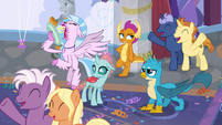 Young four surrounded by cheering students S9E7