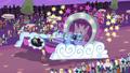 Applejack lifts up Vignette's parade float EGROF.png
