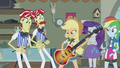 Applejack putting on bass guitar EG2.png