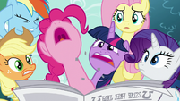 Pinkie Pie pops through the newspaper S5E19
