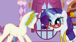 Rarity putting gold laurel leaves on the mannequin's head S1E14