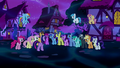 Twilight addresses the crowd of ponies S5E13.png