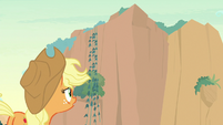 Applejack looks up at the mountain peaks S8E23
