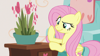 Fluttershy looking at the potted plant S7E12
