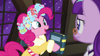 Spirit of HW Presents holding a book S6E8