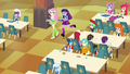 Twilight and Fluttershy walking in the cafeteria EG.png