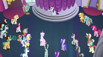 Crowd of ponies listening to Rarity S5E14