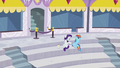 Rainbow watching aerial display; Rarity rubbing some lotion S5E15.png