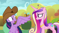 Twilight waving at Cadance with her wing S7E22