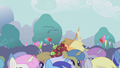 Applejack makes her way through the crowd S1E04.png