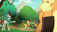Kirin pointing out of the village S8E23