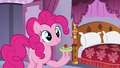 Pinkie with another cupcake on her hoof S5E14.png