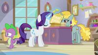 Spike walks off-screen while Rarity buys fabrics S9E19