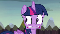 Twilight nervously looking behind her S5E23