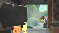 Professor Fossil peeking inside the cave S7E25