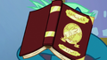 Sky Stinger with a textbook on his face S6E24.png