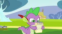 Spike looking at the notebook S2E22