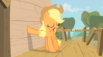 Applejack places her hoof on the tree-house's wall S1E18