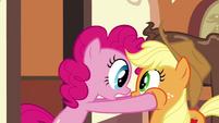 Pinkie Pie grabbing on Applejack's head S2E24