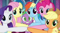 Ponies and Spike put hooves in the center S9E1