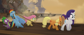 Rainbow holding the rope for ponies to cross MLPTM