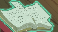 Snowfall flips through the pages of her book S06E08