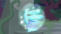 Star Swirl's journal emitting swirling magic S7E25