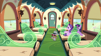 Twilight, Starlight, and Spike in an empty train car S6E16