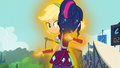 Applejack starts glowing in Twilight's hug EG3.png