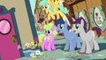 Crowd of ponies looking around corner S4E12.png