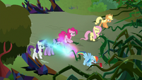 Mane Six pushing back the vines S9E2