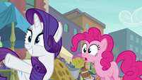 Rarity pointing across the street S6E3