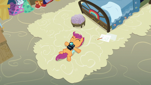 File:Scootaloo lying on Rainbow Dash's old carpet S7E7.png