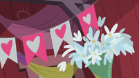 Floral and banner decorations in the barn S8E10