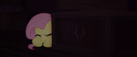 Fluttershy cowering behind a crate MLPTM