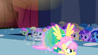Fluttershy flying down the runway S1E20