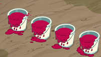 Four cans of red paint S3E8