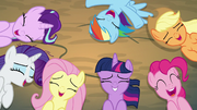 Ponies laughing together on the ground S8E13