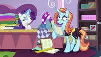 Rarity shows her sketch to Sassy Saddles S7E6