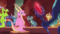 Scales looking at the Bloodstone Scepter S8E16