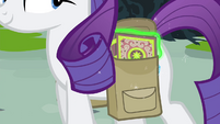 Rarity keeping the book in her saddlebag S4E23