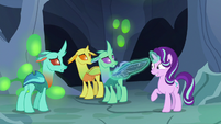 Starlight Changeling stretches a changeling's wing S7E1