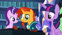 Starlight and Sunburst looking at the game board S7E24