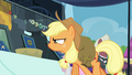 Applejack looking closely at brooch S4E22.png