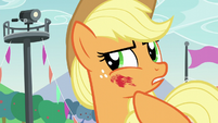Applejack wipes off hoofsie mark on her cheek S5E24